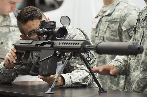 A US Army soldier looks over a Barrett M107A1 rifle