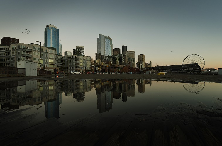 The sun sets over the downtown business area of Seattle