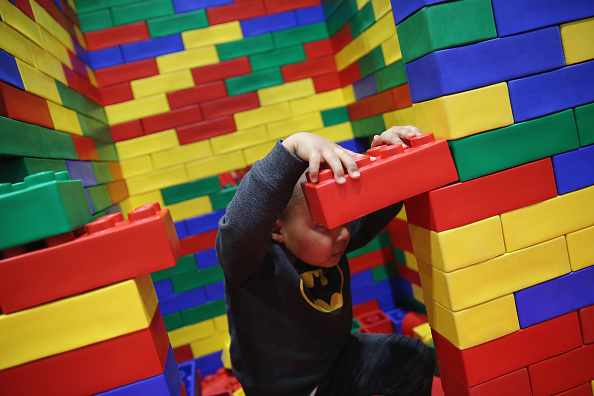 Kid laying with Legos