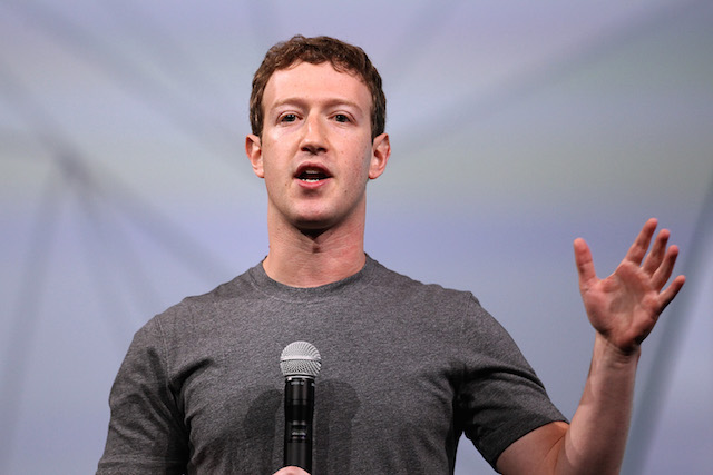 Mark Zuckerberg is talking behind a microphone on stage.