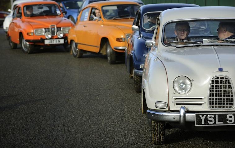 Vintage Saab 96s lead the procession dur
