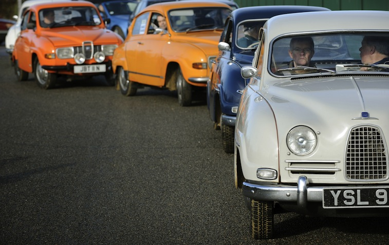 Vintage Saab 96s lead the procession dur