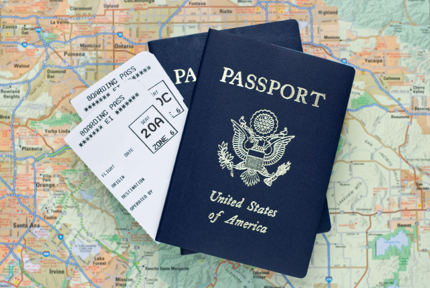 Airplane boarding passes, passport, travel, map