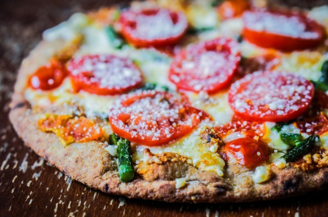 Pizza with tomatoes, cheese, and asparagus