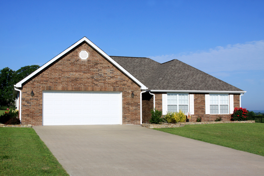 brick house with driveway