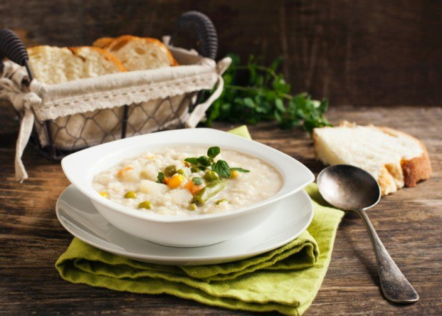 Chowder with rice and vegetables. Selective focus on the centre
