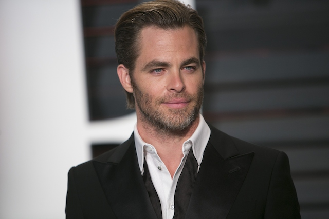 Chris Pine posing in a suit