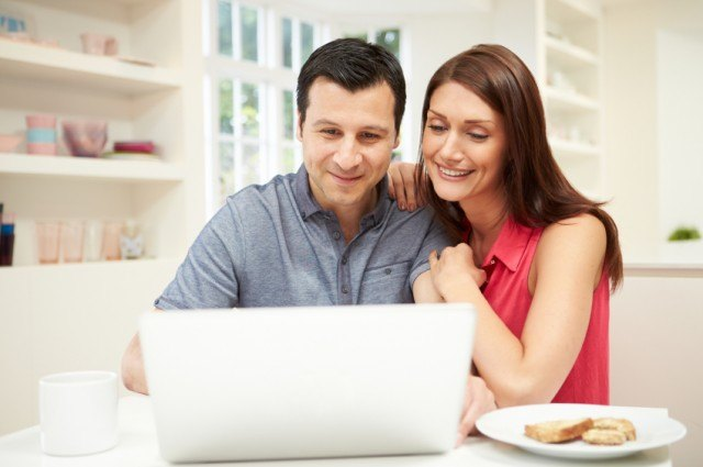 couple look at laptop