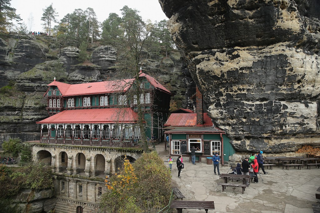 A wooden palace called Falcon's Nest, which today houses a pub frequented by hikers, stands in the Pravcicka Brana rock formation in an area known as Czech Switzerland (Ceske Svycarsko) on October 26, 2014 near Hrensko, Czech Republic. Ceske Svycarsko, located in northern Bohemia along the Elbe River near the border to Germany, is a popular tourist destination and is known for its dramatic rock formations, hiking and rock climbing. (Photo by Sean Gallup/Getty Images)