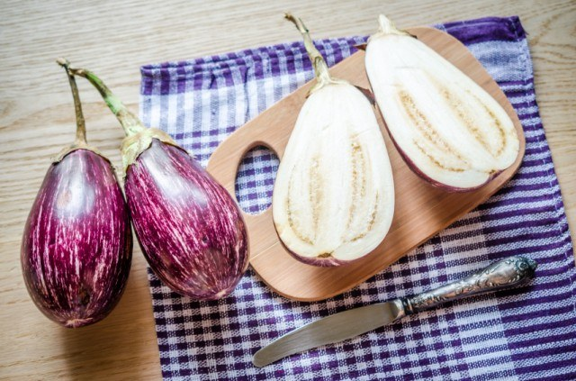Whole and halved eggplant