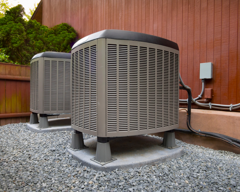 An AC heat pump unit outside of a home.