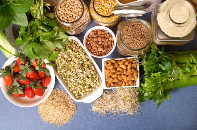 bowls of nuts, legumes, fruit, and vegeables