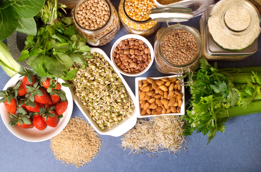 bowls of nuts, legumes, fruit, and vegetables