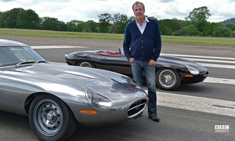 Jeremy Clarkson stands in between to cars in Top Gear