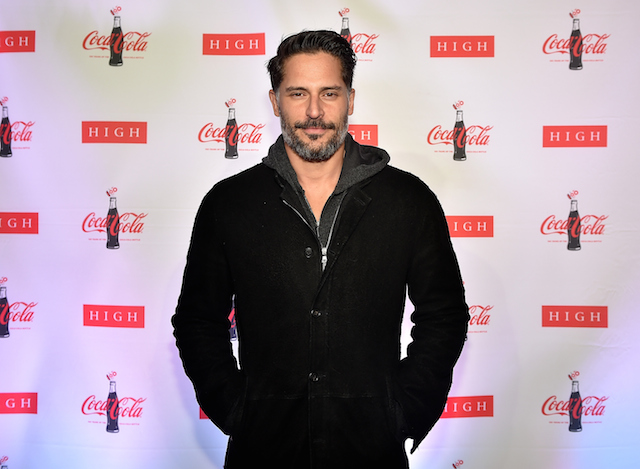 Joe Manganiello poses on the red carpet with his hands in his pockets.