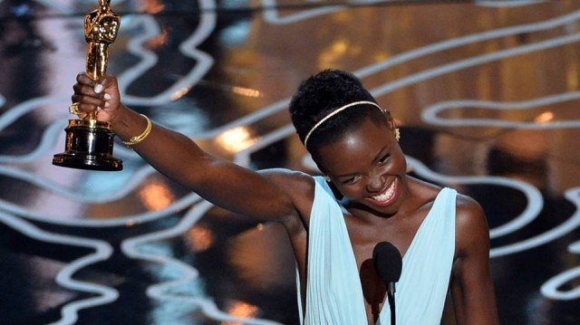 Lupita Nyong'o accepting her Academy Award for Best Supporting Actress