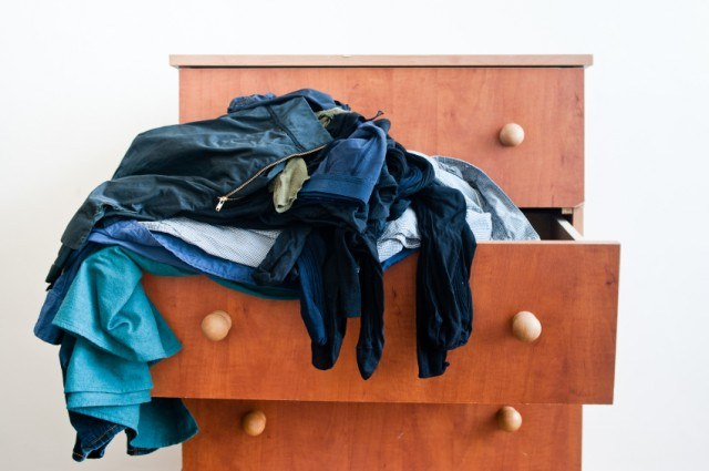 Junky drawer with clothes falling out
