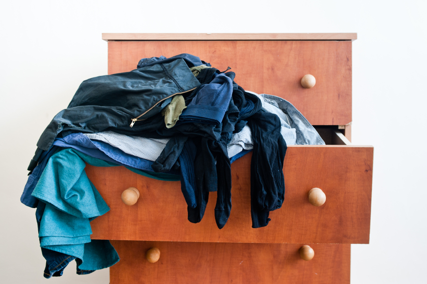 Messy brown chest of drawers