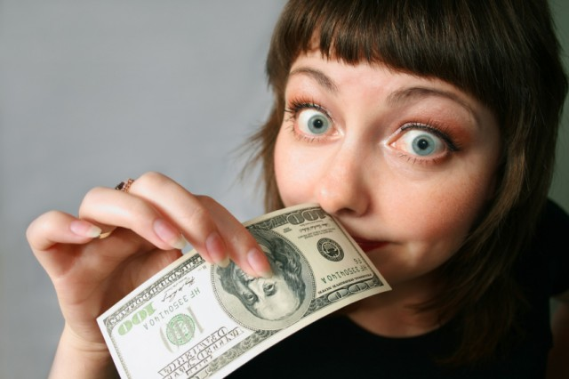 Woman smelling money