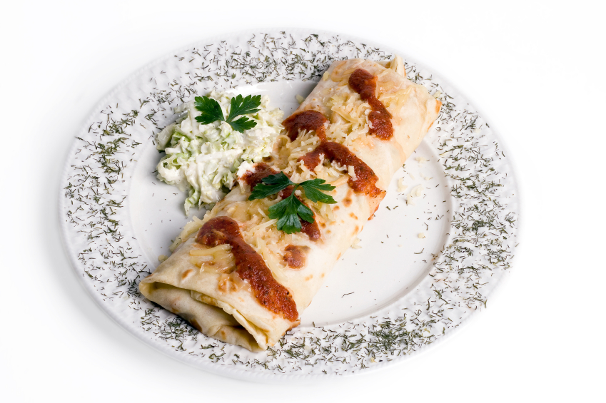 burrito with cheese and chives on top