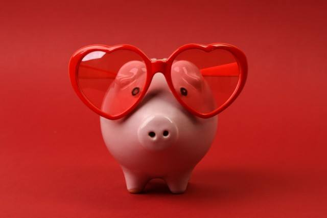 Piggy bank with heart sunglasses on