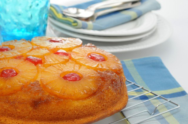 Pineapple upside down cake on a cooling rack