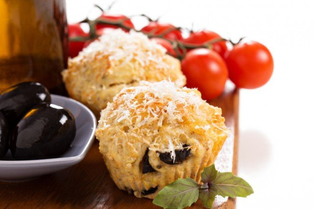 olive chia muffins with tomatoes and oil in background