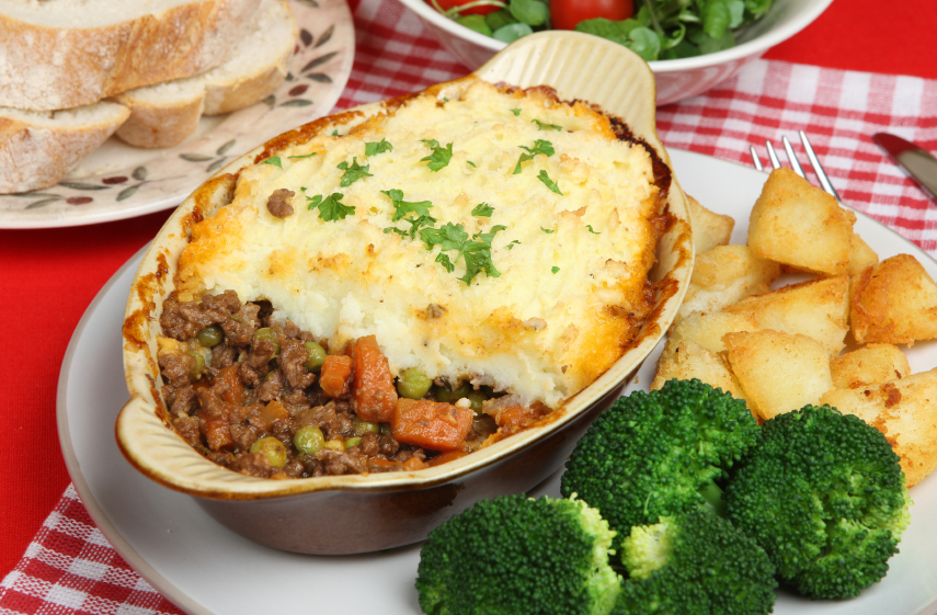 hearty shepherd's pie with carrots, peas, and mashed potatoes