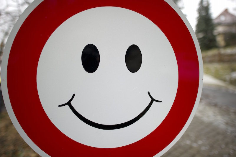 A smiley is fixed to a 'no entry'- sign in Dresden, eastern Germany, on January 16, 2012. (Photo by Arno Burgi/AFP/Getty Images)