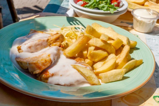 veal in a cream sauce with thick-cut fries