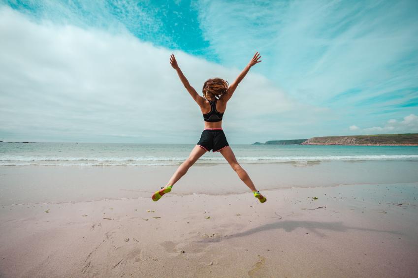 woman doing star jump