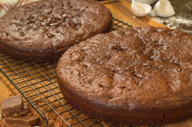 chocolate cakes cooling on cake rack