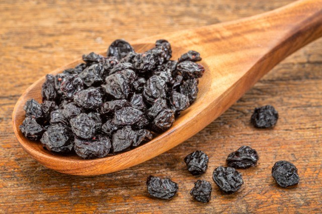 dried blueberries on a spoon