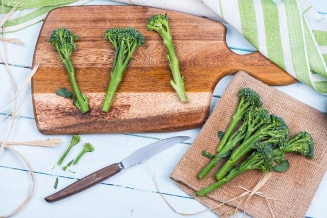 Broccolini freshly cut on a cutting board