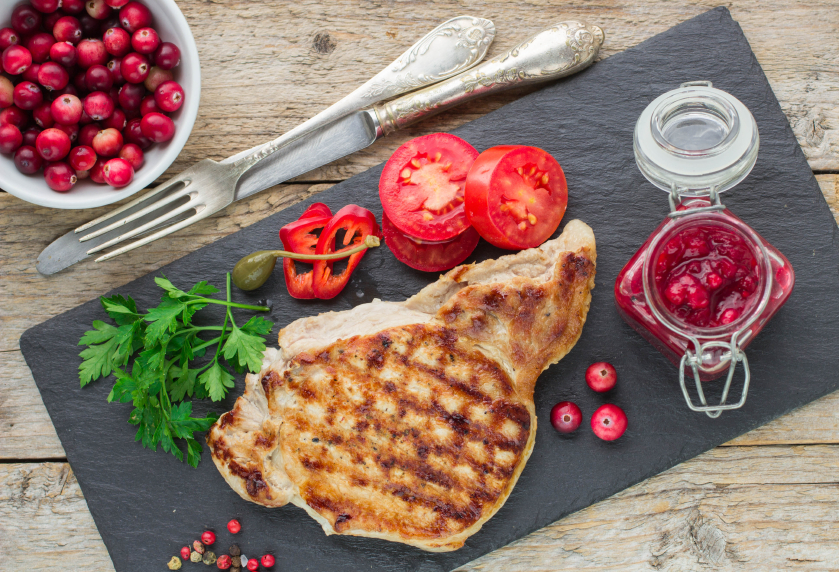 grilled pork chops with cranberries and tomatoes