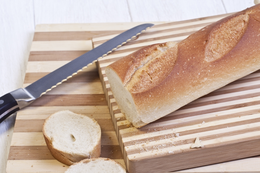 A French baguette on a bread board