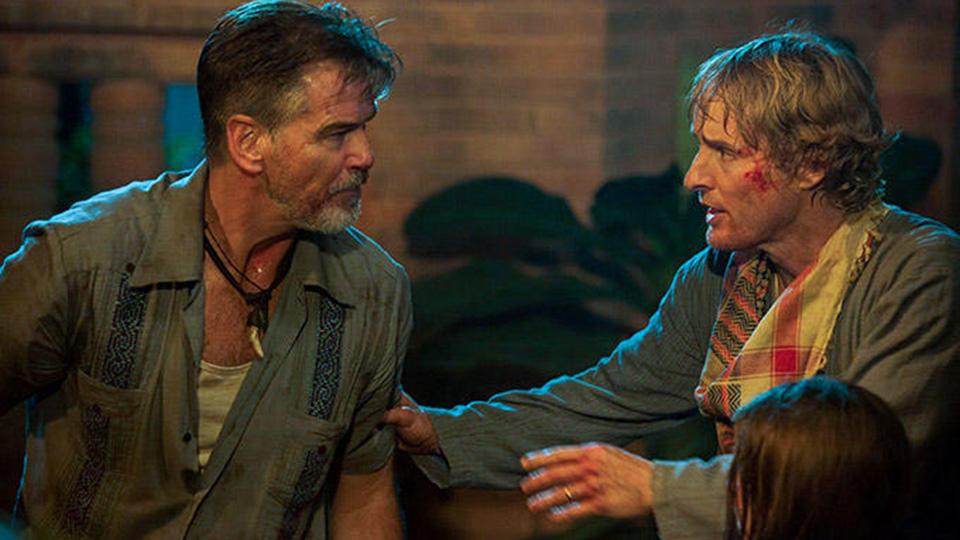 Pierce Brosnan talks to a bloodied Owen Wilson in No Escape