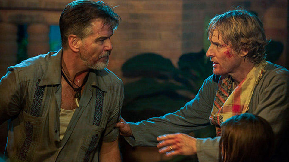 Pierce Brosnan talks to a bloodied Owen Wilson in No Escape