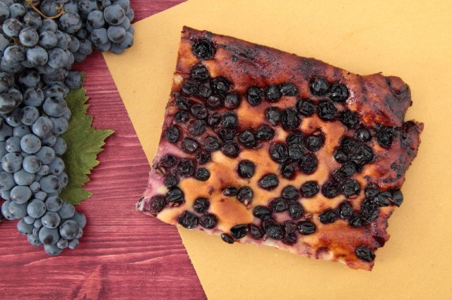 pizza focaccia with grapes on yellow paper