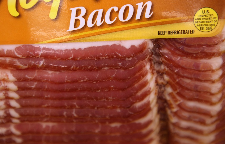A package of bacon is displayed on a shelf
