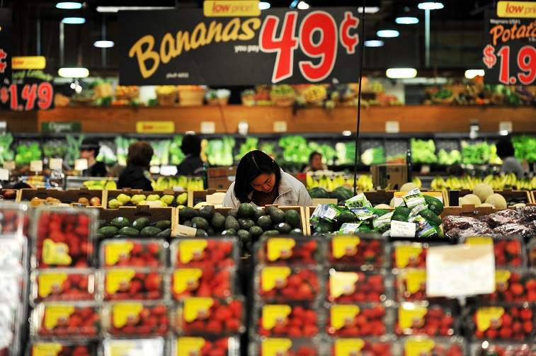 a woman shops at Wegmans Foods store in Fairfax, Virginia - Source: Jewel Samad/AFP/Getty Images