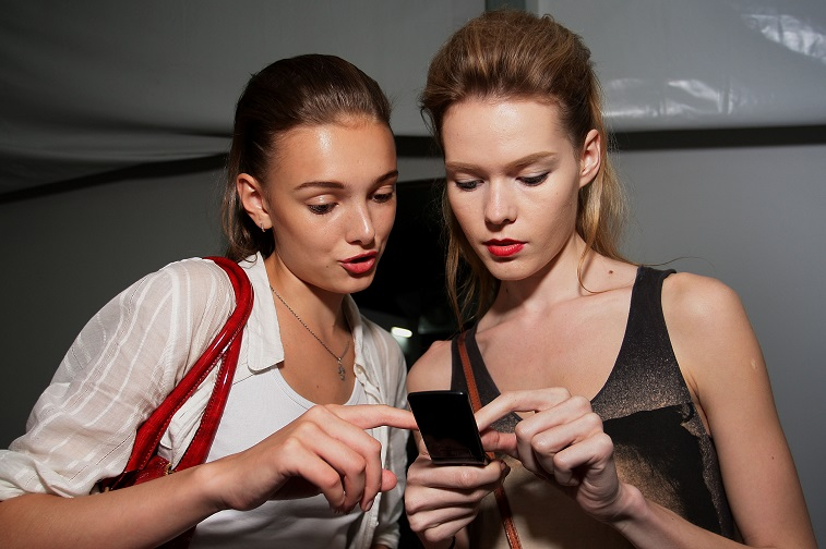 Models check a phone backstage ahead of the Missoni show - Source: Lisa Maree Williams/Getty Images for Audi Fashion Festival