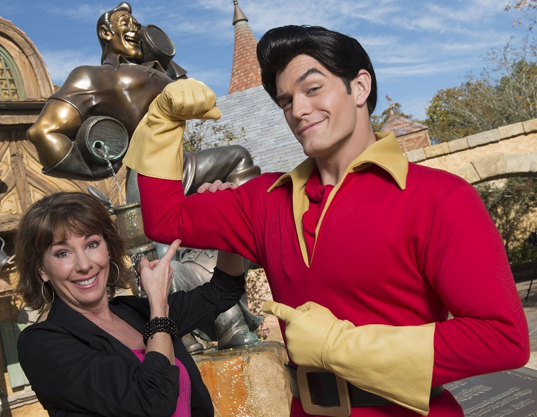 """Paige O'Hara poses with Disney's """"Beauty and the Beast"""" character Gaston"""