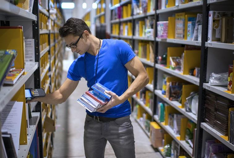 An Amazon employee sorts products