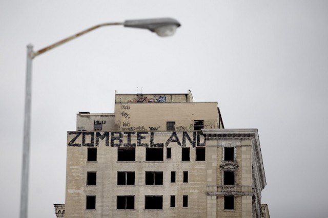 Graffiti covers an abandoned building in Detroit, MI - Source: J.D. Pooley/Getty Images