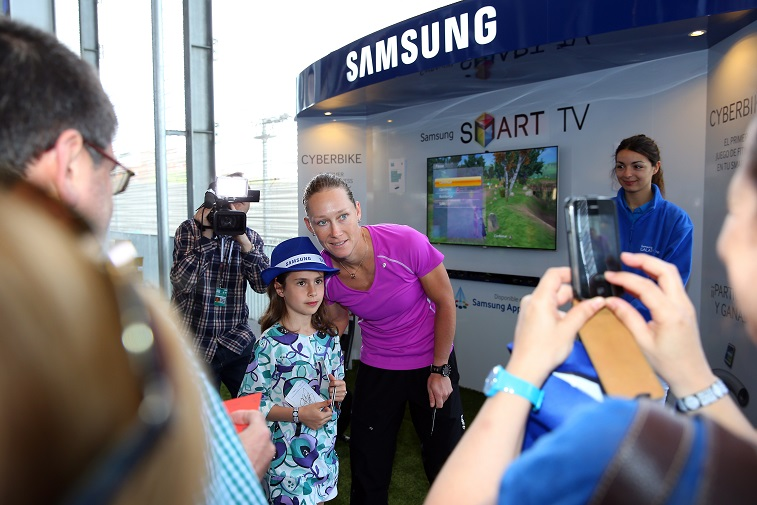 People visit the Samsung stand and takes part in a cycle game during the Mutua Madrid Open - Source: Julian Finney/Getty Images