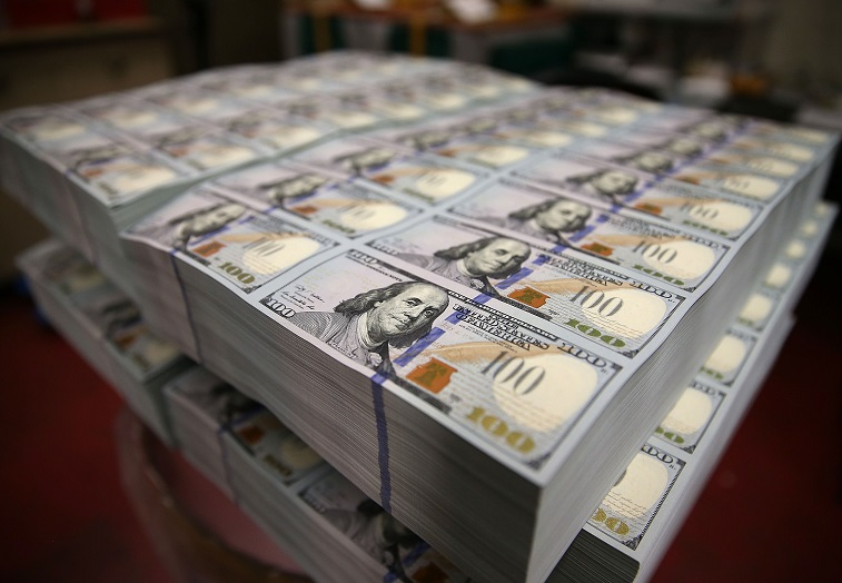 $100 notes lay in stacks at the Bureau of Engraving and Printing