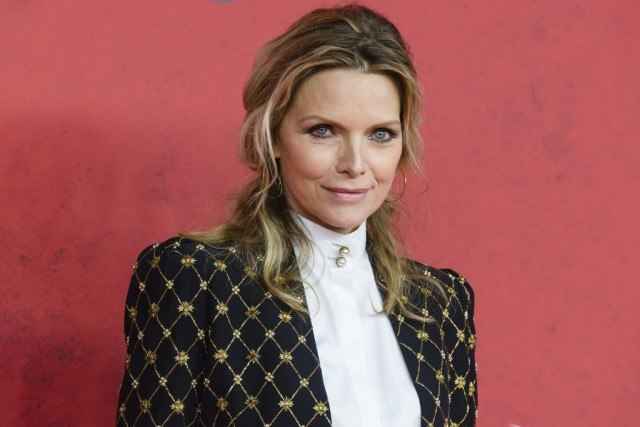 Michelle Pfeiffer poses on a red carpet