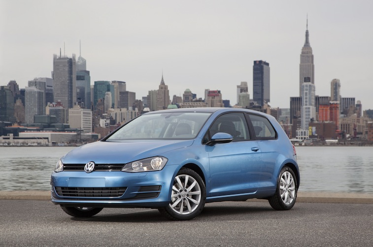 A blue 2015 Volkswagen Golf sits parked in New York, New York