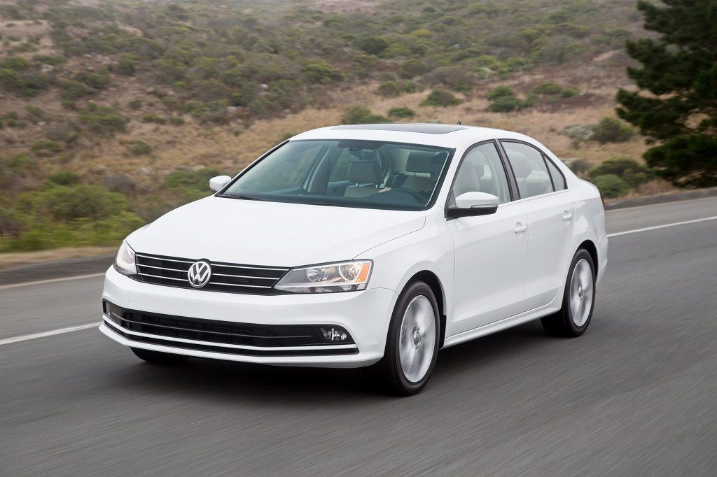 View of white 2016 Volkswagen Jetta driving down country road